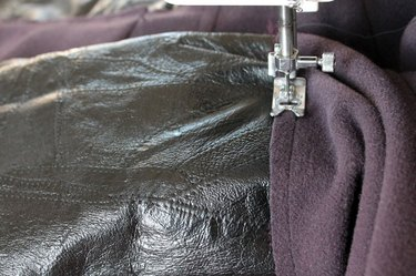 Place the sleeve on the sleeve arm to sew.