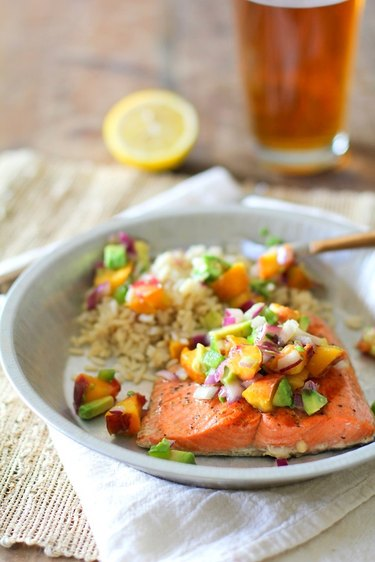 Grilled salmon covered with peach salsa.