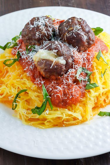 Roasted Garlic Pasta Sauce served with shredded spaghetti squash and mozzarella-stuffed meatballs