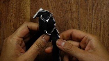 Braiding zippers to make a braided bracelet.