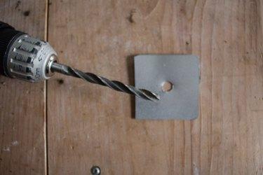 Drill hole in aluminum lid