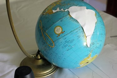 Tape the templates to the globe.