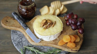 drizzling honey on top of brie