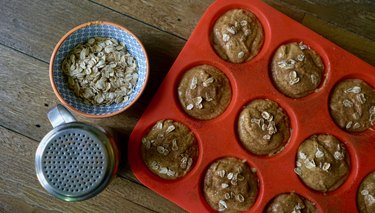Pumpkin oat blender muffins topped with oats and cinnamon