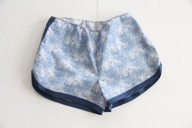 sew a gathering stitch around the shorts waistband