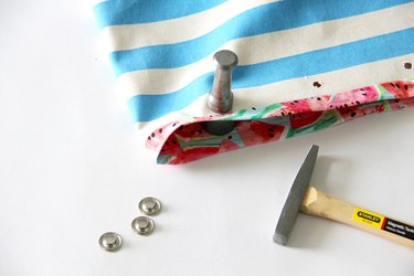 Use a mallet to hammer in grommets