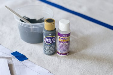 Use fabric paint to make the drop cloth washable.
