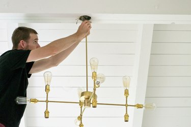 Install the chandelier to ceiling box housing