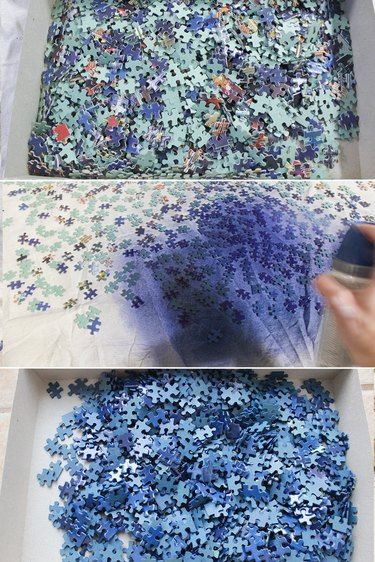 Spraying blue puzzle pieces