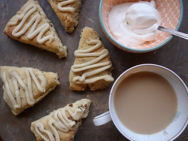 Gluten free low carb maple pecan scones with a cup of tea and whipped cream