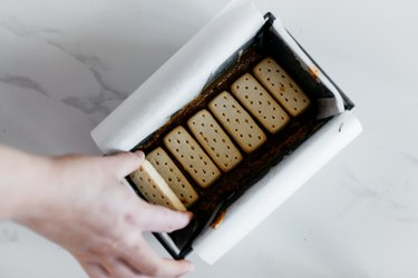Press the shortbread biscuits into the caramel in an even layer.