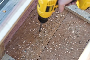 Using a drill, drill holes for drainage.