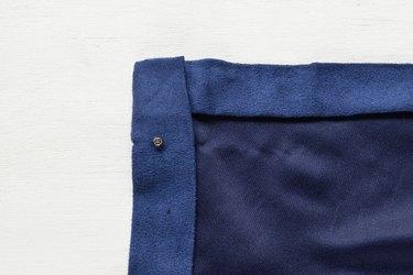Insert the cap through the fabric