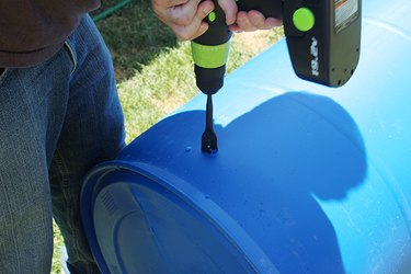 drilling a hole into the plastic barrel