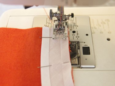 Sew in the fold line closest to the edge.