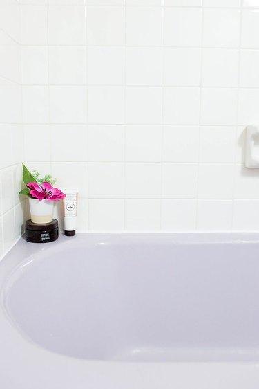 Purple bathtub with newly installed caulk