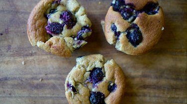 Nut butter banana muffins with almond butter and topped with blueberries