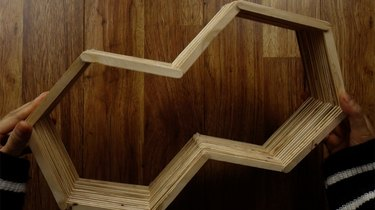 Unfinished DIY hexagon shelf made out of popsicle sticks