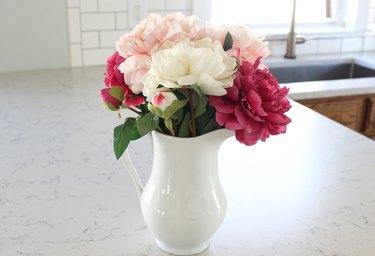 Arrange flowers in vase