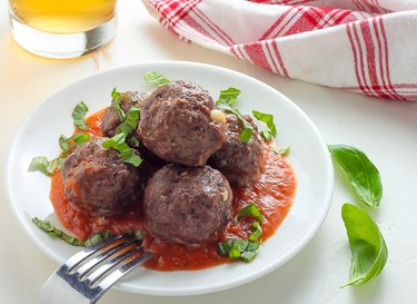 Meatballs covered in roasted garlic tomato sauce.