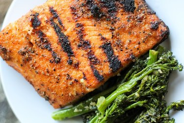 Grilled salmon on a plate with broccolini