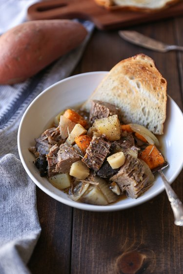 slow cooker post roast in a bowl with toast
