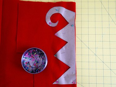 The zigzag design pinned to red felt.