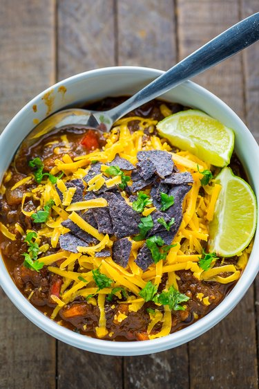 Black Bean and Pumpkin Chili topped with cilantro, tortilla chips and cheddar cheese.
