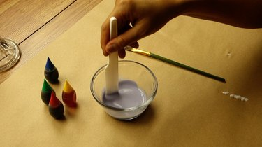 Mixing food coloring into glue to create a faux sea glass effect on glass decor.