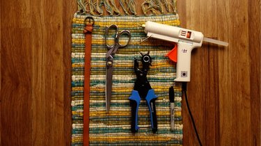 Materials for upcycled no-sew clutch from a placemat and belt