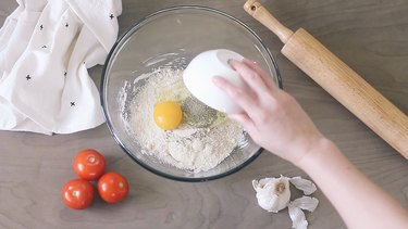 Adding ingredients to bowl