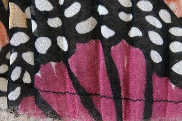 Hem the bottom of the pleated fabric piece.