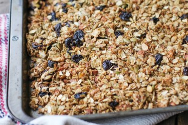 Finished granola on a baking sheet