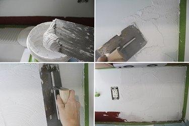 Applying mastic to wall.