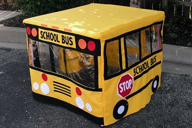 Front and side view of school bus playhouse.