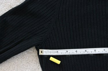 Measure and mark across the back of the sweater.