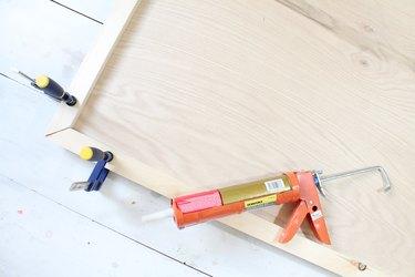 Glue framing pieces to headboard