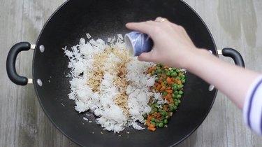 adding sesame oil to the rice