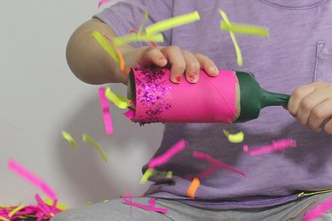 child popping the party popper