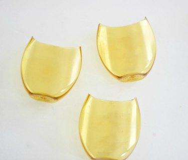 Three shaped vessels.
