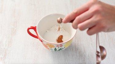 adding dry ingredients to mug