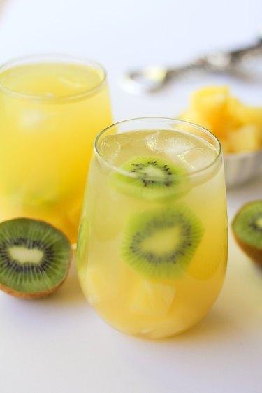 Two glasses of pineapple kiwi sangria.