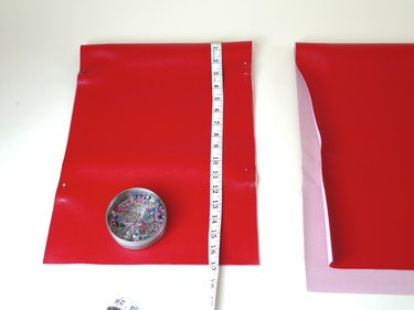 Folded piece of vinyl measured and cut to the proper measurements.