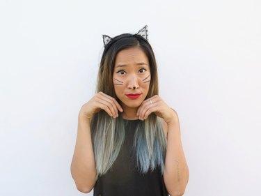 Wearing the lace cat ears.