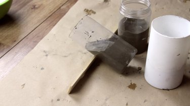 Letting cement set in desired shape for DIY candles with cement base project