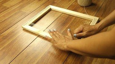 Checking tension while warping DIY simple frame loom.