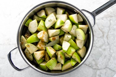 Sliced apples, sugar and spices for the apple butter.