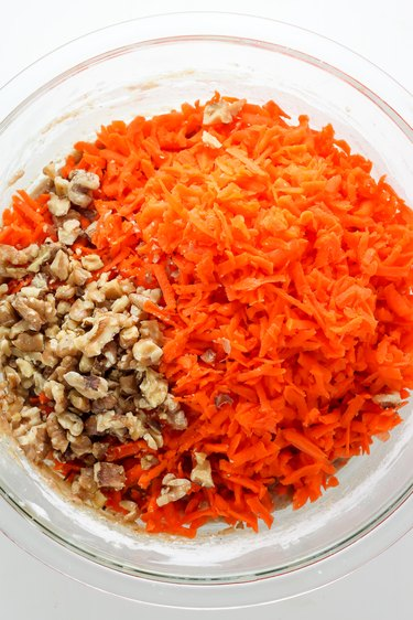 Add in the carrots and nuts; mix to combine.