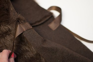 Sew the ribbon to the front of the cape.
