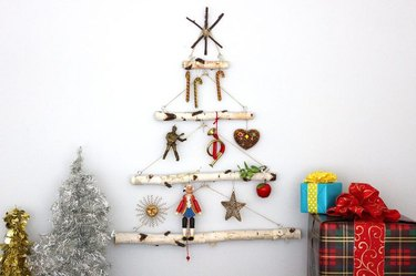 A four tiered hanging birch branch tree with ornaments